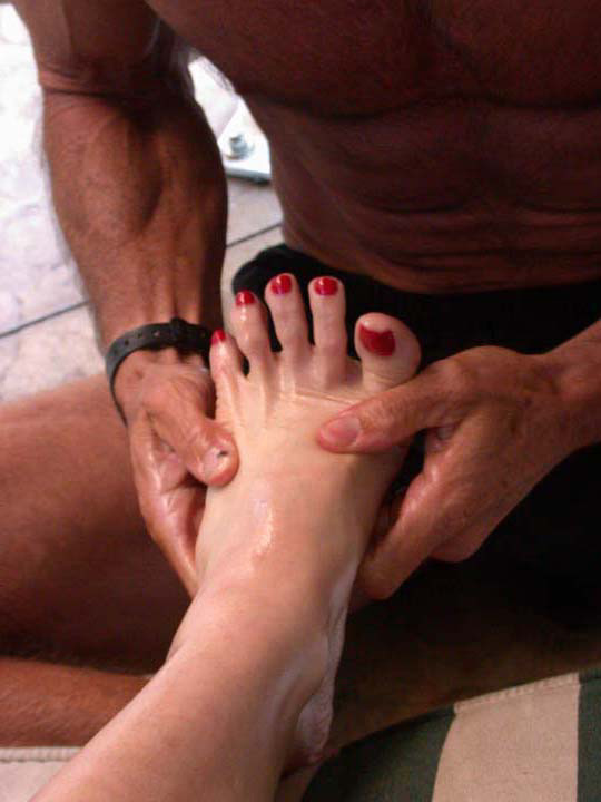 Mistress Tara Indiana having her foot worshipped